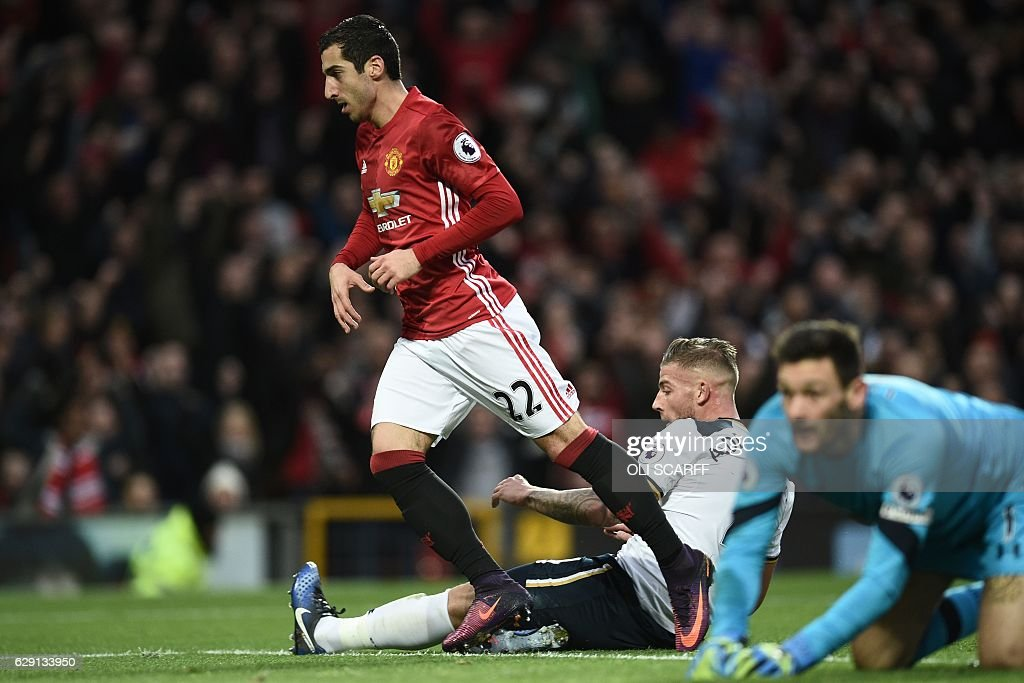 Manchester United's Armenian midfielder Henrikh Mkhitaryan (L) celebrates scoring the opening goal as Tottenham Hotspur's Belgian defender Toby Alderweireld (C) and Tottenham Hotspur's French goalkeeper Hugo Lloris react during the English Premier League football match between Manchester United and Tottenham Hotspur at Old Trafford in Manchester, north west England, on December 11, 2016. / AFP / OLI SCARFF / RESTRICTED TO EDITORIAL USE. No use with unauthorized audio, video, data, fixture lists, club/league logos or 'live' services. Online in-match use limited to 75 images, no video emulation. No use in betting, games or single club/league/player publications. /