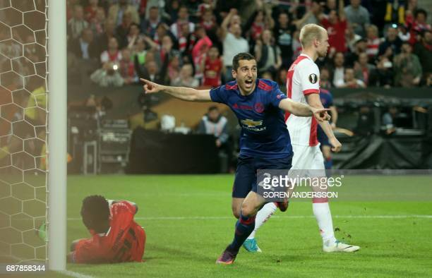 Manchester United's Armenian midfielder Henrikh Mkhitaryan celebrates after scoring the 02 against Ajax Cameroonian goalkeeper Andre Onana during the...