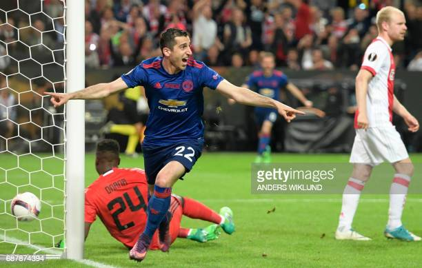 Manchester United's Armenian midfielder Henrikh Mkhitaryan celebrates scoring during the UEFA Europa League final football match Ajax Amsterdam v...