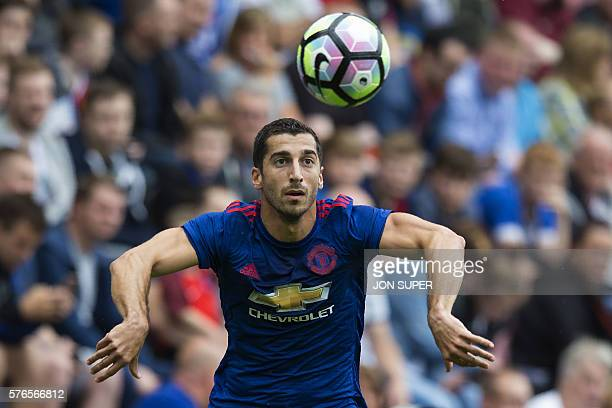 Manchester United's Armenian midfielder Henrikh Mkhitaryan controls the ball during the preseason friendly football match between Wigan Athletic and...