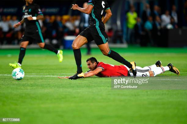 Manchester United's Armenian midfielder Henrikh Mkhitaryan lies on the lawn during the UEFA Super Cup football match between Real Madrid and...