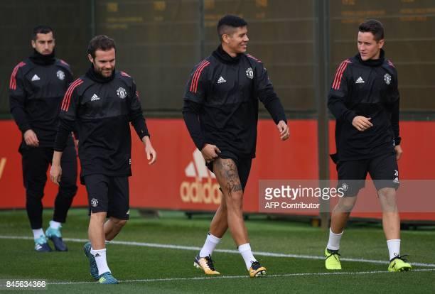 Manchester United's Armenian midfielder Henrikh Mkhitaryan Manchester United's Spanish midfielder Juan Mata Manchester United's Argentinian defender...