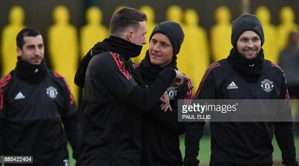 Manchester United's Armenian midfielder Henrikh Mkhitaryan Manchester United's Spanish midfielder Ander Herrera and Manchester United's Dutch...