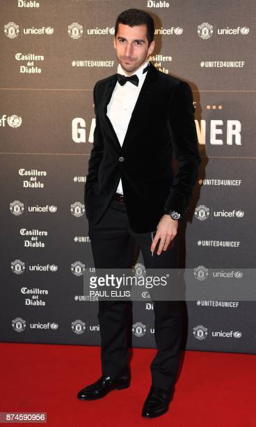 Manchester United's Armenian midfielder Henrikh Mkhitaryan poses on the red carpet as he arrives to attend the 'United for UNICEF Gala Dinner' at Old...