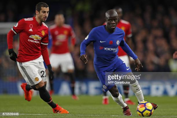 Manchester United's Armenian midfielder Henrikh Mkhitaryan vies with Chelsea's French midfielder N'Golo Kante during the English Premier League...