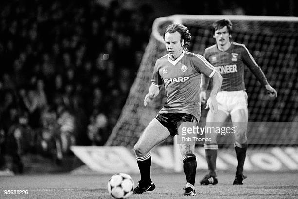 Manchester United's Arthur Graham on the ball watched by Ipswich Town's Kevin Steggles during their Division One football match held at Portman Road,...
