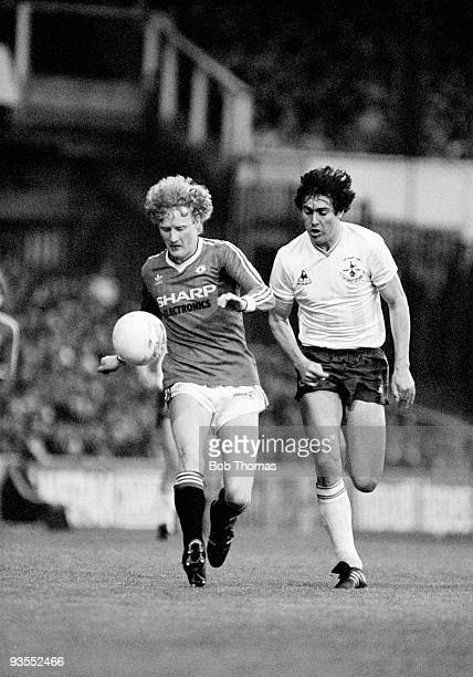 Manchester United's Ashley Grimes is watched closely by Tottenham Hotspur defender Paul Miller during their Division One match played at White Hart...