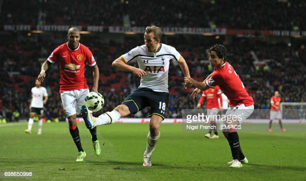 Manchester United's Ashley Young and Rafael Da Silva challenge Tottenham Hotspur's Harry Kane for the ball