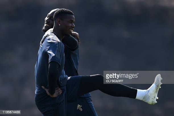 Manchester United's Belgian forward Romelu Lukaku and Manchester United's French midfielder Paul Pogba attend a training session at the Carrington...