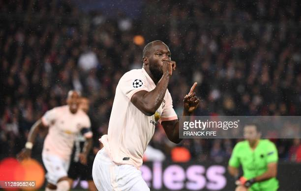 TOPSHOT Manchester United's Belgian forward Romelu Lukaku celebrates after scoring a goal during the UEFA Champions League round of 16 secondleg...