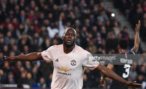 Manchester United's Belgian forward Romelu Lukaku celebrates after scoring his team's second goal during the UEFA Champions League round of 16...