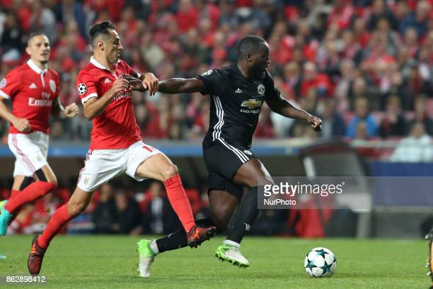 Manchester United's Belgian forward Romelu Lukaku fights for the ball with Benfica's Brazilian forward Jonas during the UEFA Champions League...