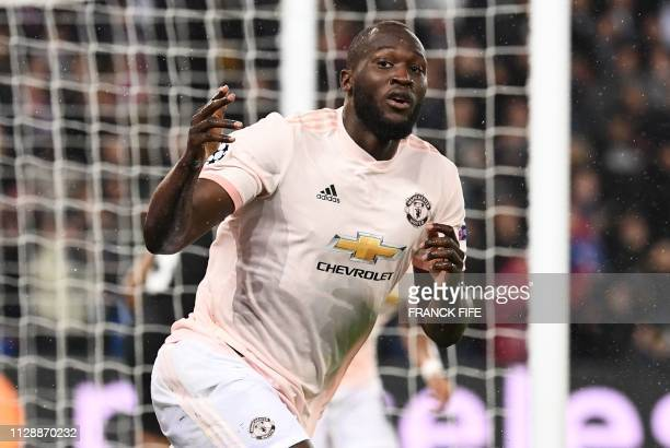 TOPSHOT Manchester United's Belgian forward Romelu Lukaku looks on during the UEFA Champions League round of 16 secondleg football match between...