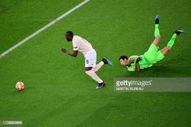 TOPSHOT Manchester United's Belgian forward Romelu Lukaku runs to score his team's first goal during the UEFA Champions League round of 16 secondleg...