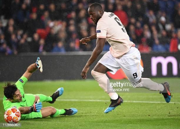 Manchester United's Belgian forward Romelu Lukaku vies for the ball with Paris SaintGermain's Italian goalkeeper Gianluigi Buffon prior to score the...