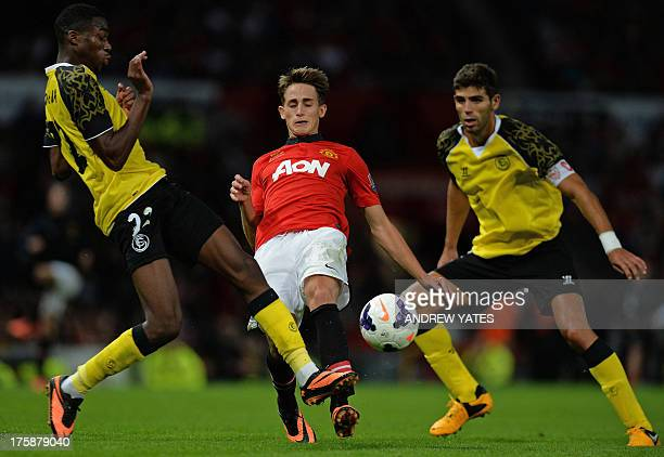 Manchester United's Belgian midfielder Adnan Januzaj vies with Sevilla's French midfielder Geoffrey Kondogbia during the preseason friendly football...