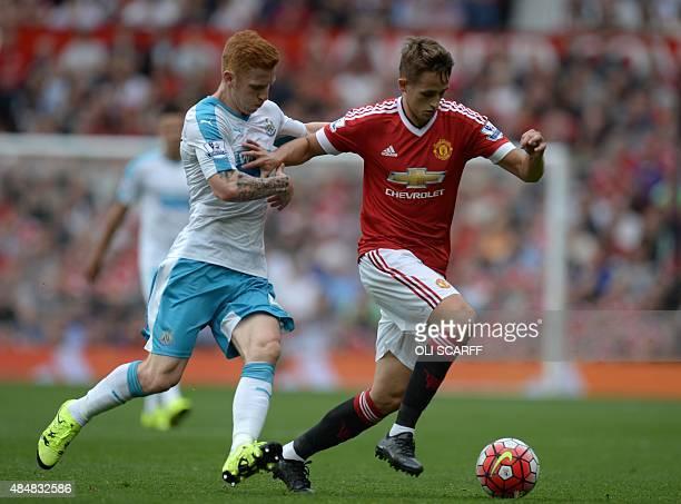 Manchester United's Belgian midfielder Adnan Januzaj vies with Newcastle United's English midfielder Jack Colback during the English Premier League...