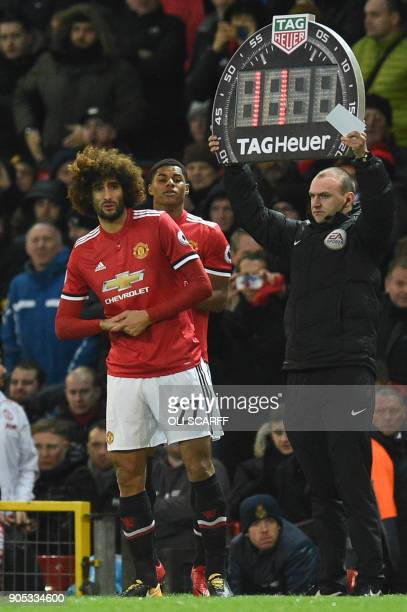 Manchester United's Belgian midfielder Marouane Fellaini and Manchester United's English striker Marcus Rashford prepare to come on as substitutes...