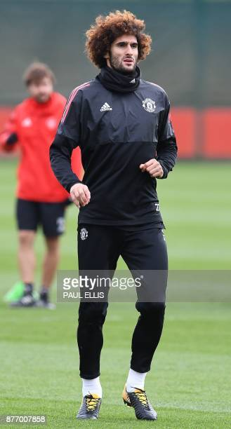Manchester United's Belgian midfielder Marouane Fellaini attends a team training session at the club's training complex near Carrington west of...