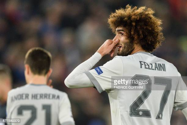 Manchester United's Belgian midfielder Marouane Fellaini gestures during the UEFA Champions League Group A football match between FC Basel and...