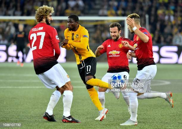 Manchester United's Belgian midfielder Marouane Fellaini Manchester United's Spanish midfielder Juan Mata and Manchester United's Belgianborn...
