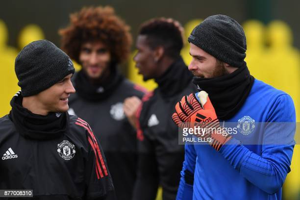 Manchester United's Belgian midfielder Marouane Fellaini Manchester United's French midfielder Paul Pogba and Manchester United's Spanish goalkeeper...