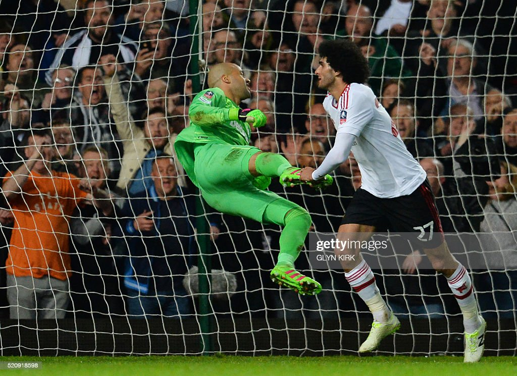 Manchester United's Belgian midfielder Marouane Fellaini (R) scores past West Ham United's Irish goalkeeper Darren Randolph to make it 2-0 during the FA cup quarter final replay football match between West Ham United and Manchester United at the Boleyn ground in London on April 13, 2016. / AFP / GLYN
