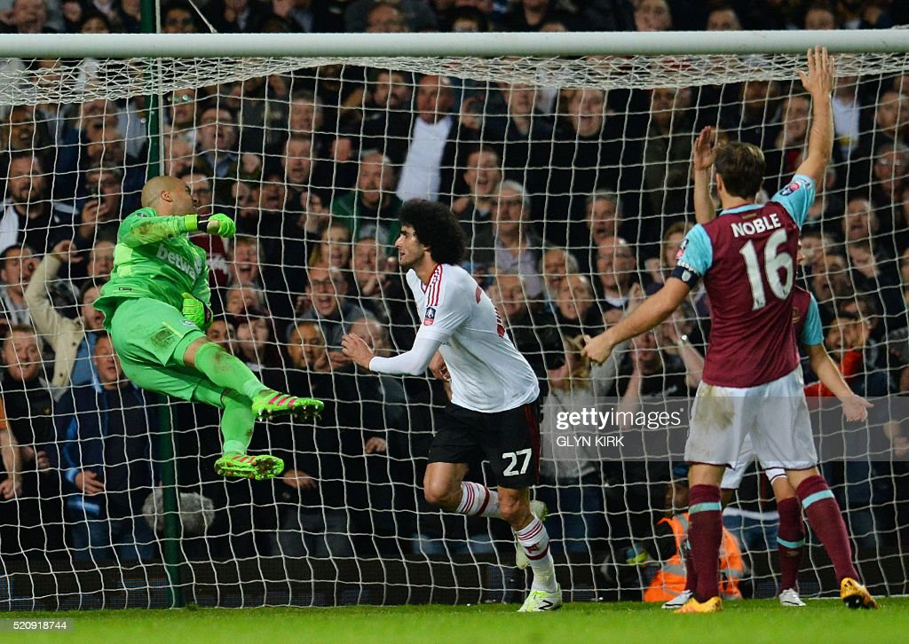 Manchester United's Belgian midfielder Marouane Fellaini (C) scores past West Ham United's Irish goalkeeper Darren Randolph to make it 2-0 during the FA cup quarter final replay football match between West Ham United and Manchester United at the Boleyn ground in London on April 13, 2016. / AFP / GLYN