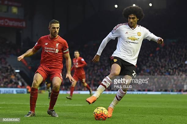 Manchester United's Belgian midfielder Marouane Fellaini turns away from Liverpool's English midfielder Jordan Henderson during the English Premier...