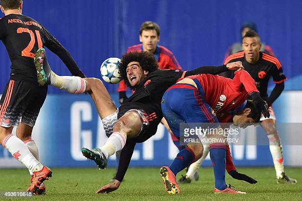 Manchester United's Belgian midfielder Marouane Fellaini vies for the ball with CSKA Moscow's Russian midfielder Alan Dzagoev during the UEFA...