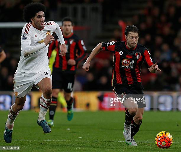 Manchester United's Belgian midfielder Marouane Fellaini vies with Bournemouth's Englishborn Irish midfielder Harry Arter during the English Premier...