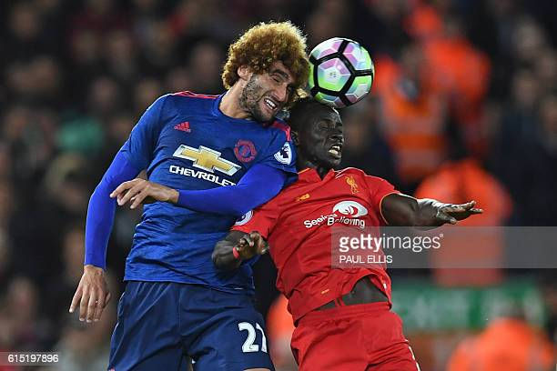 Manchester United's Belgian midfielder Marouane Fellaini vies with Liverpool's Senegalese midfielder Sadio Mane during the English Premier League...