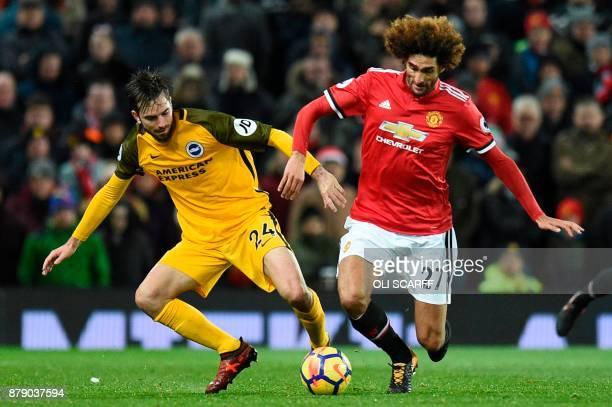 Manchester United's Belgian midfielder Marouane Fellaini vies with Brighton's Dutch midfielder Davy Propper during the English Premier League...