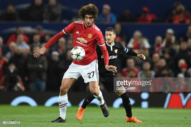 Manchester United's Belgian midfielder Marouane Fellaini vies with Sevilla's Spanish midfielder Pablo Sarabia during a last 16 second leg UEFA...