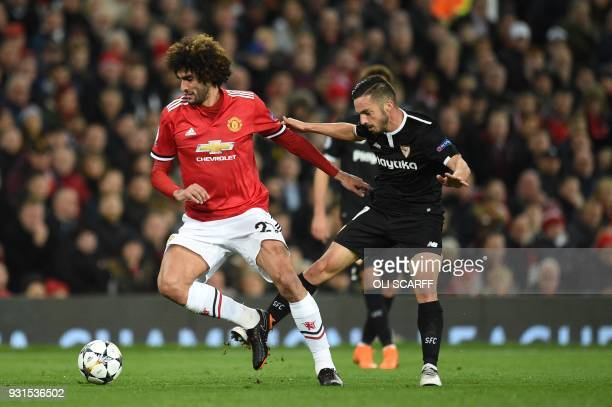 Manchester United's Belgian midfielder Marouane Fellaini vies with Sevilla's Spanish midfielder Pablo Sarabia during a last 16 second leg UEFA...