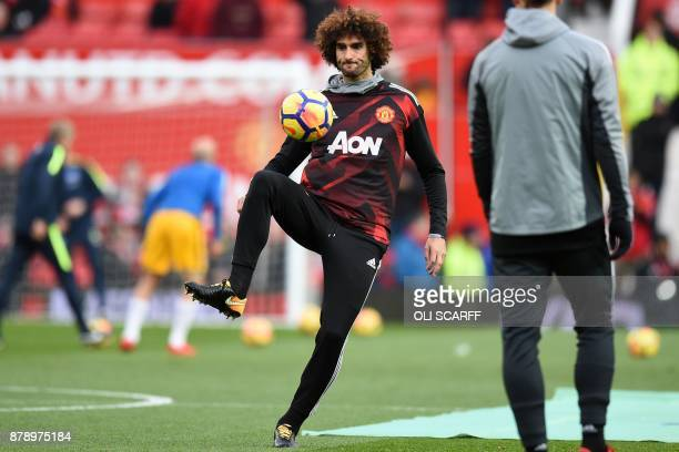 Manchester United's Belgian midfielder Marouane Fellaini warms up ahead of the English Premier League football match between Manchester United and...