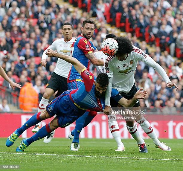Manchester United's Belgian midfielder Marouane Fellaini wins a header from Crystal Palace's Australian midfielder Mile Jedinak during the English FA...