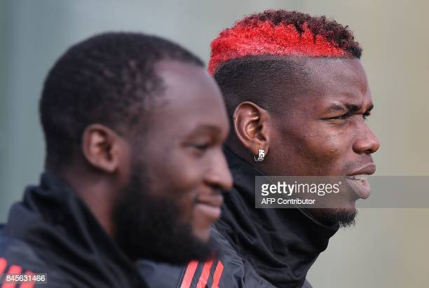 Manchester United's Belgian striker Romelu Lukaku and Manchester United's French midfielder Paul Pogba attends a team training session at the club's...