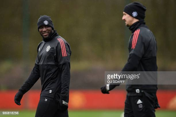 Manchester United's Belgian striker Romelu Lukaku and Manchester United's Swedish striker Zlatan Ibrahimovic attend a team training session at the...