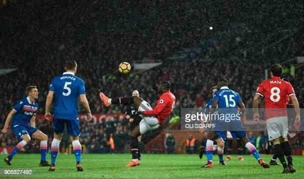 TOPSHOT Manchester United's Belgian striker Romelu Lukaku attempts to play the ball over his head during the English Premier League football match...