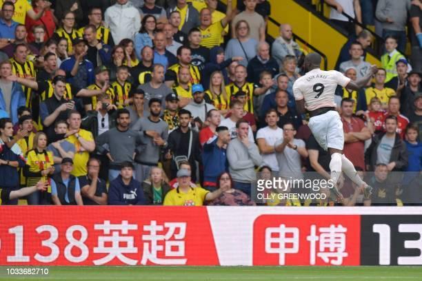 Manchester United's Belgian striker Romelu Lukaku celebrates after scoring during the English Premier League football match between Watford and...