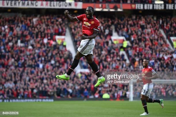 Manchester United's Belgian striker Romelu Lukaku celebrates after scoring their third goal during the English Premier League football match between...