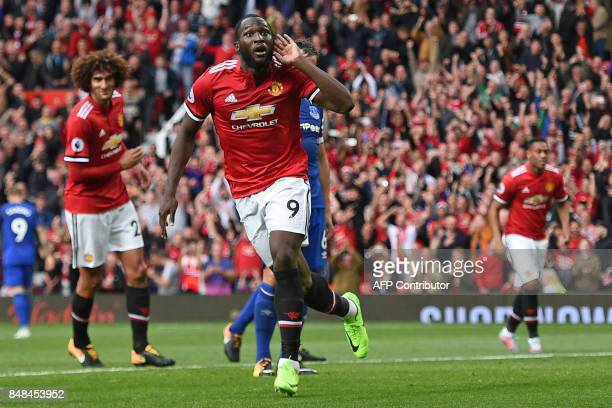 Manchester United's Belgian striker Romelu Lukaku celebrates after scoring their third goal during the English Premier League football match between...