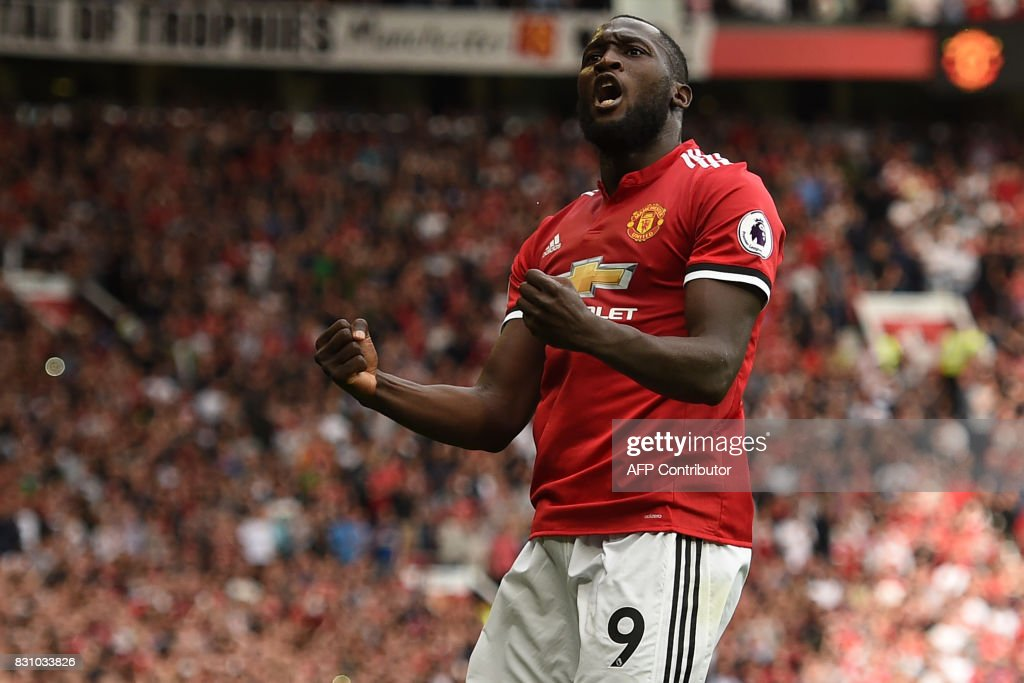 Manchester United's Belgian striker Romelu Lukaku celebrates scoring the opening goal during the English Premier League football match between Manchester United and West Ham United at Old Trafford in Manchester, north west England, on August 13, 2017. / AFP PHOTO / Oli SCARFF / RESTRICTED TO EDITORIAL USE. No use with unauthorized audio, video, data, fixture lists, club/league logos or 'live' services. Online in-match use limited to 75 images, no video emulation. No use in betting, games or single club/league/player publications. /