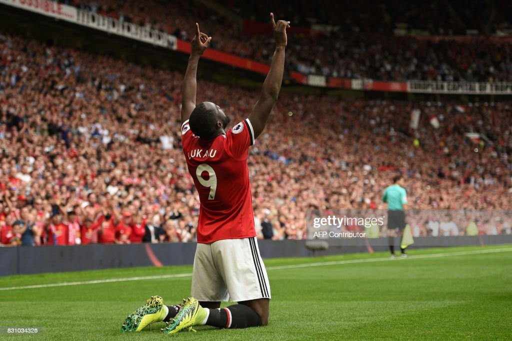 TOPSHOT - Manchester United's Belgian striker Romelu Lukaku celebrates scoring the opening goal during the English Premier League football match between Manchester United and West Ham United at Old Trafford in Manchester, north west England, on August 13, 2017. / AFP PHOTO / Oli SCARFF / RESTRICTED TO EDITORIAL USE. No use with unauthorized audio, video, data, fixture lists, club/league logos or 'live' services. Online in-match use limited to 75 images, no video emulation. No use in betting, games or single club/league/player publications. /