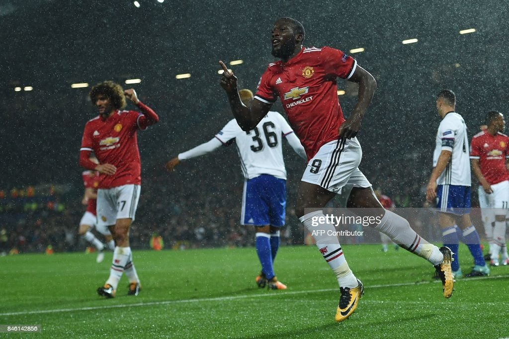 Manchester United's Belgian striker Romelu Lukaku celebrates scoring his team's second goal during the UEFA Champions League Group A football match between Manchester United and Basel at Old Trafford in Manchester, north west England on September 12, 2017. / AFP PHOTO / Oli SCARFF