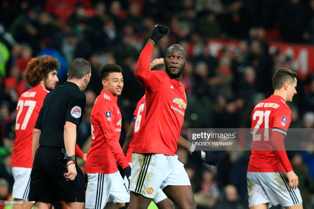Manchester United's Belgian striker Romelu Lukaku (C) celebrates scoring their second goal during the English FA Cup third round football match between Manchester United and Derby County at Old Trafford in Manchester, north west England, on January 5, 2018. / AFP PHOTO / Lindsey PARNABY / RESTRICTED TO EDITORIAL USE. No use with unauthorized audio, video, data, fixture lists, club/league logos or 'live' services. Online in-match use limited to 75 images, no video emulation. No use in betting, games or single club/league/player publications. /
