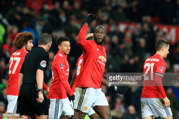Manchester United's Belgian striker Romelu Lukaku celebrates scoring their second goal during the English FA Cup third round football match between...