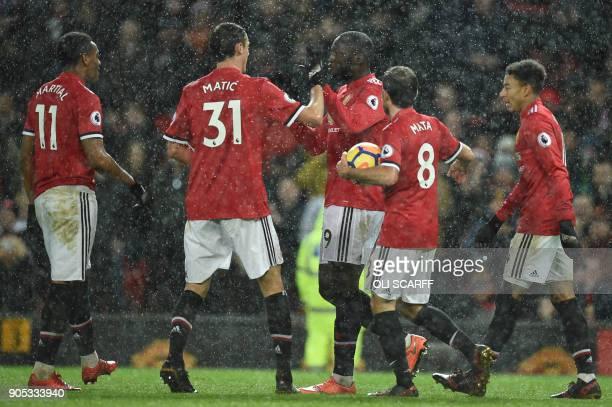 Manchester United's Belgian striker Romelu Lukaku celebrates scoring their third goal during the English Premier League football match between...