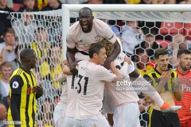 Manchester United's Belgian striker Romelu Lukaku celebrates their second goal during the English Premier League football match between Watford and...